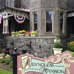 Reynolds Mansion sign and newly planted mums