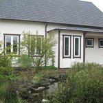 Home in residential neighborhood with beautiful garden.