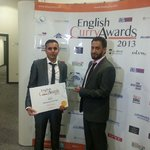 """Our management collecting the """"BEST INDIAN RESTAURANT IN ENGLAND"""" 2013 award"""