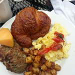 Fresh Basil & Tomato Egg Scramble, Roasted Potatoes, Rosemary Apple Sausage, Croissant & Fruit