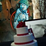 cake with artwork in background
