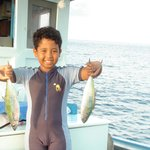 Sammy (elder son) loved the fishing trip arranged by the owner of Tao Thong Villa #2