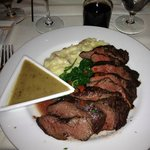 Perfectly cooked hangar steak with mashed potatoes and green peppercorn sauce