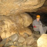 Inside cave listening to guide