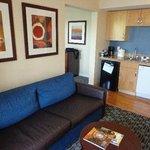 Sofa & full kitchen in separate room