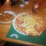 Tasty pizza and wedges
