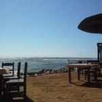 Sitting area near water and hotel nightclub/bar