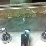 Mold on mirror in bathroom