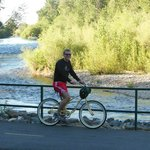 Enjoy bikes rented from hotel for a leisurely ride along the river
