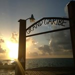 Sunrise view with Grand Caribe sign on pier