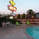 fabulous motel sign and vintage umbrella by the pool