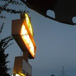 the motel sign at night from under the umbrella- very atmospheric!