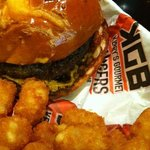 Stuffed spicy burger with tater tots.