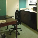 bar/desk area with adjoining room door