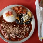 chipolte plate with rice, black beans and tomatoes