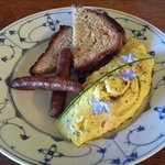 Home baked bread!  Home-made sausage!  Amazing omelet with farm fresh eggs!