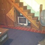 TV under the stairs.