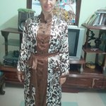 russian customer try on her silk jacket