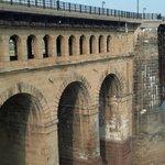 Arches decorate the bridge ramp