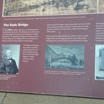 Informational plaque about bridge near riverfront