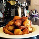A plate of roasts potatoes put out on the bar after the last meal was served; they were lovely..