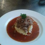 Shredded Shoulder of Welsh Lamb,with sliced garlic and cream potatoes