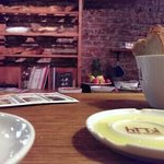 Rosemary extra virgin olive oil, hand made bread, cosy background with a selection of homey smal