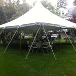Back lawn set up with catering tent.