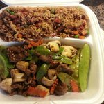 Single dinner meal with fried rice with beef and snow peas