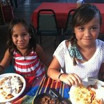 my kids enjoying their chicken enchiladas !!
