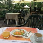 Breakfast in the gardens at Molino d'Era, Volterra, Italy