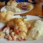 Salmon, shrimp, crab in puffed pastry, with garlic knot and cheesy potatoes
