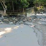 Stream flows into beach