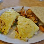 Omelet w/sausage, bacon, onions, peppers and home fries