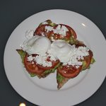 Avocado, feta and tomato on sourdough bread with eggs from Deli 1886