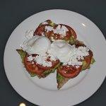 Avocado, feta and tomato on sourdough bread with eggs from Deli 1886