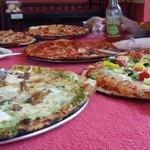 White pizza, veggie pizza, bacon/sausage/ham pizza, pepperoni pizza, cheeseburger pizza