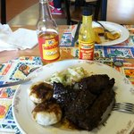 Jerk Ribs, Dumplings, and Cabbage!  Flavor was spot on, and the cabbage was to die for.  Their c