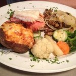 Lobster tail, double stuffed potato and steak with loads of veggies! delicious!