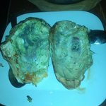 the oyster shells are used as plates to serve the baked oysters