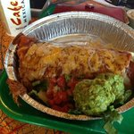 Sweet pork burrito with enchilada sauce