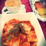 Beef ravioli in a homemade italian sausage sauce, delicious!