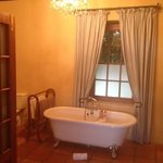 Victoria style Tuscan bath tub with heated tile floors