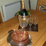 Surprise birthday cake and champagne