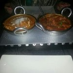 king prawn ceylon on the right and lamb Vindaloo on the left