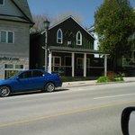 Walking along Metcalfe Street in Elora. Strata Gallery.