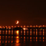 Crescent moon over the bridge to canada