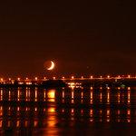 Crescent moon over the bridge to canada