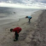 The kids writing their names in the sand