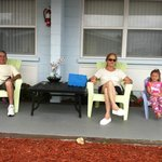 Pili, Carlos and Krystal on the front porch of two room suite